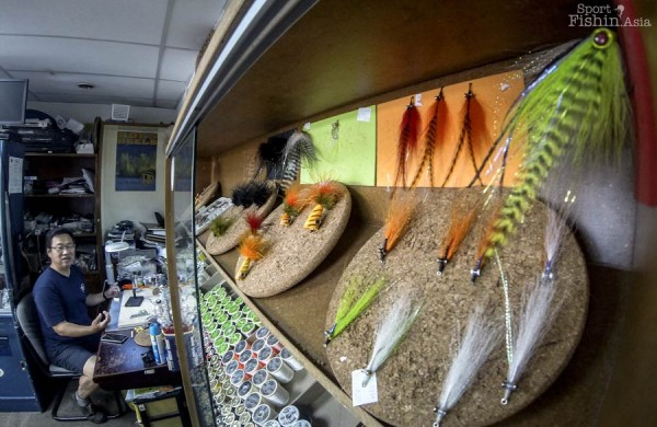 Nick at his fly tying station and some of his proven fish catching flies in the foreground