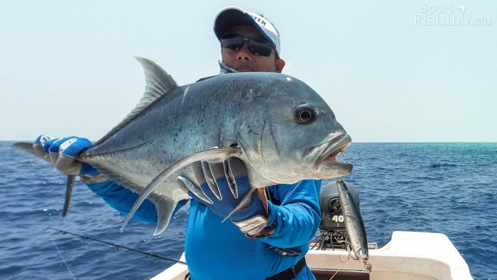 Serious Angler, Din, with a decent giant trevally. Photo taken with the HTC Re Camera.