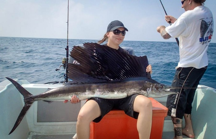 An early double hook-up for the German couple. Eli pictured with her sailfish while Andre battles his fish.