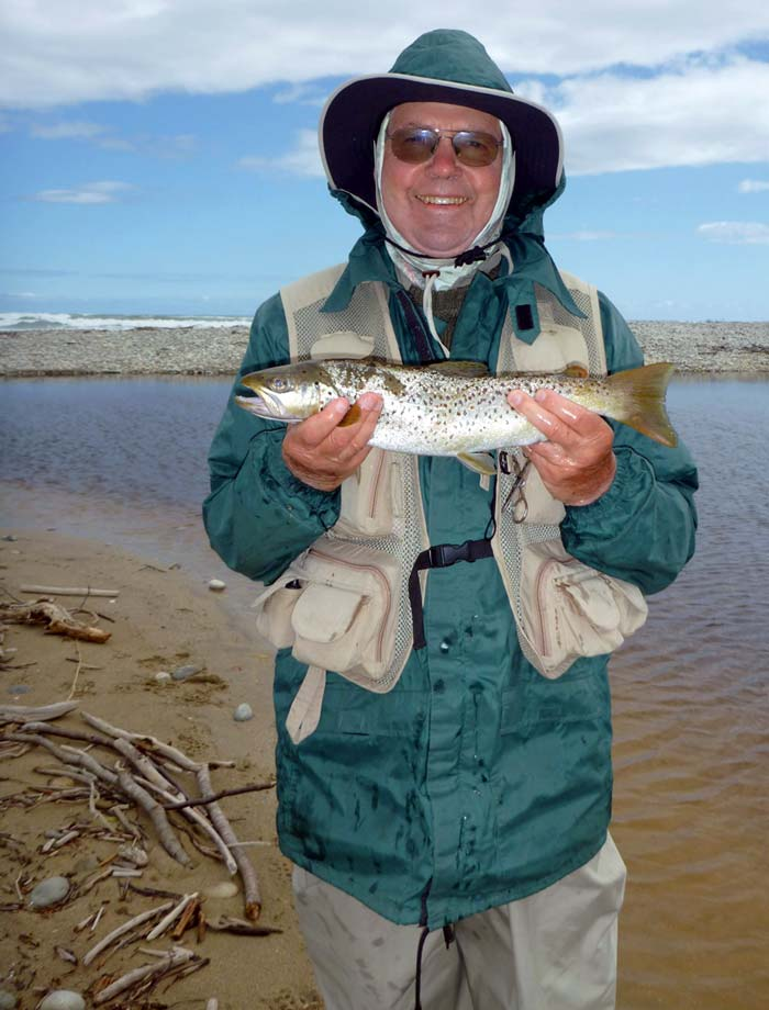 Fly caught sea trout with Southern Ocean breakers in background