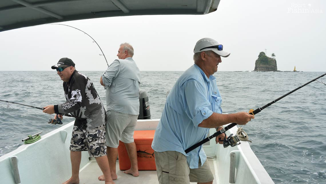 Steven, Stuart and David manouvering their fish around the boat