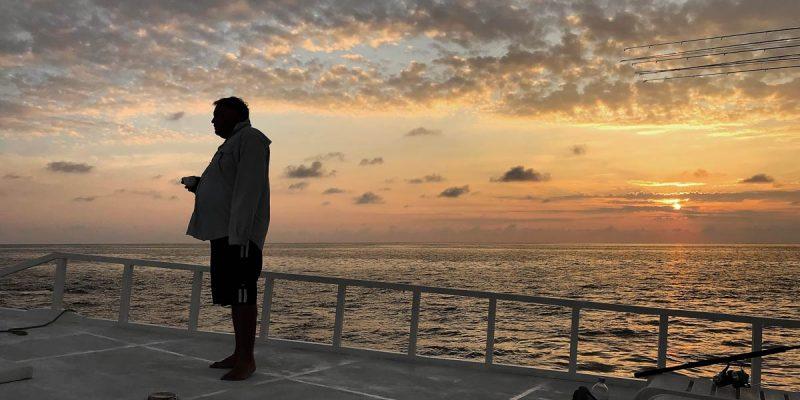 Sunrise on deck of Maldives motherboat