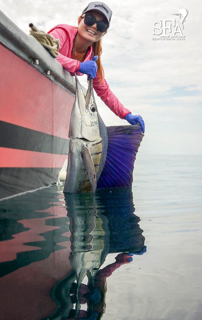 Our lady guest with her catch. Note how calm the sea can be in Rompin!