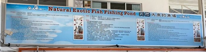 The sign above the payment counter and entrance to fishing area