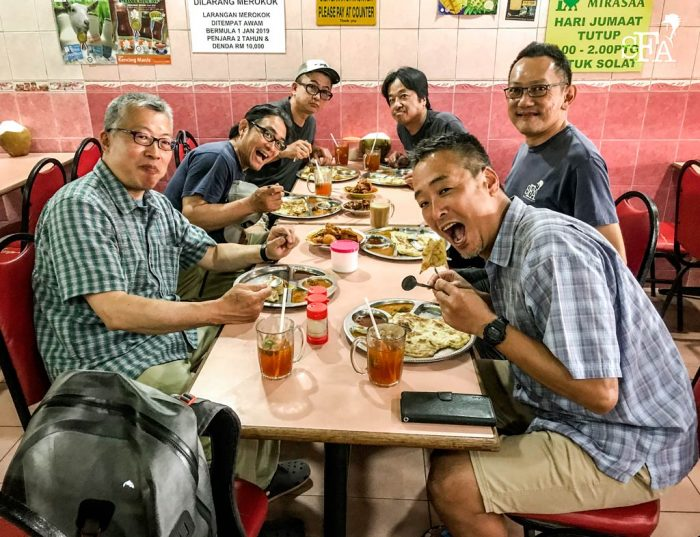The guys and JW having roti canai breakfast at a restaurant in the suburbs