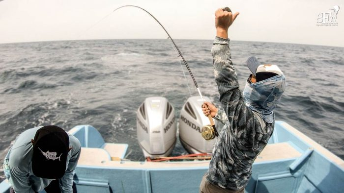 Shono San punches his fist and screams in delight having finally got a solid hookup on his first Rompin sailfish