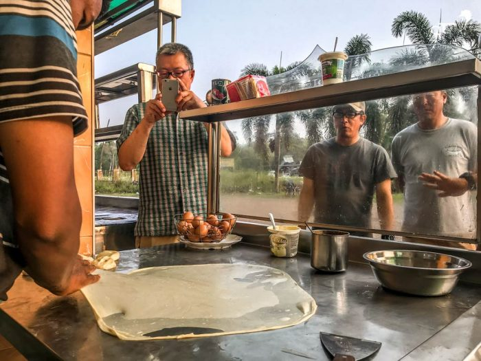 The guys fascinated with how the roti canai is made