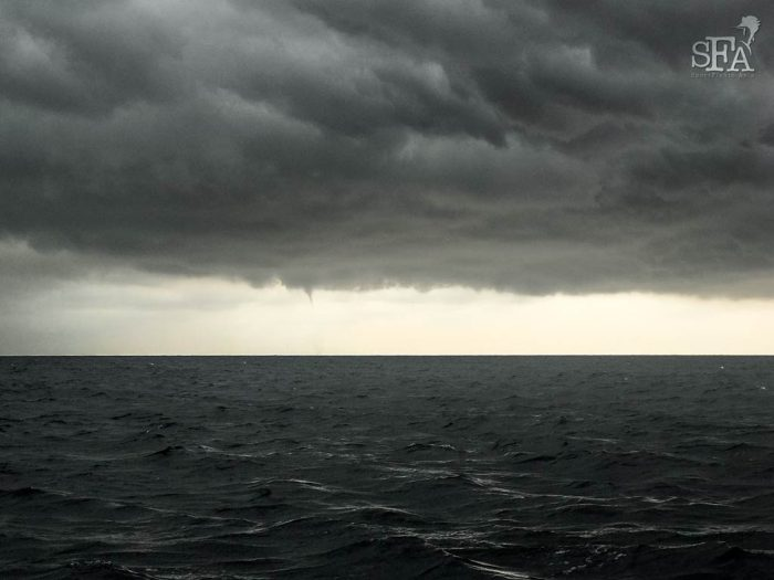 Waterspouts starting to form in the clouds - three waterspouts appeared eventually!