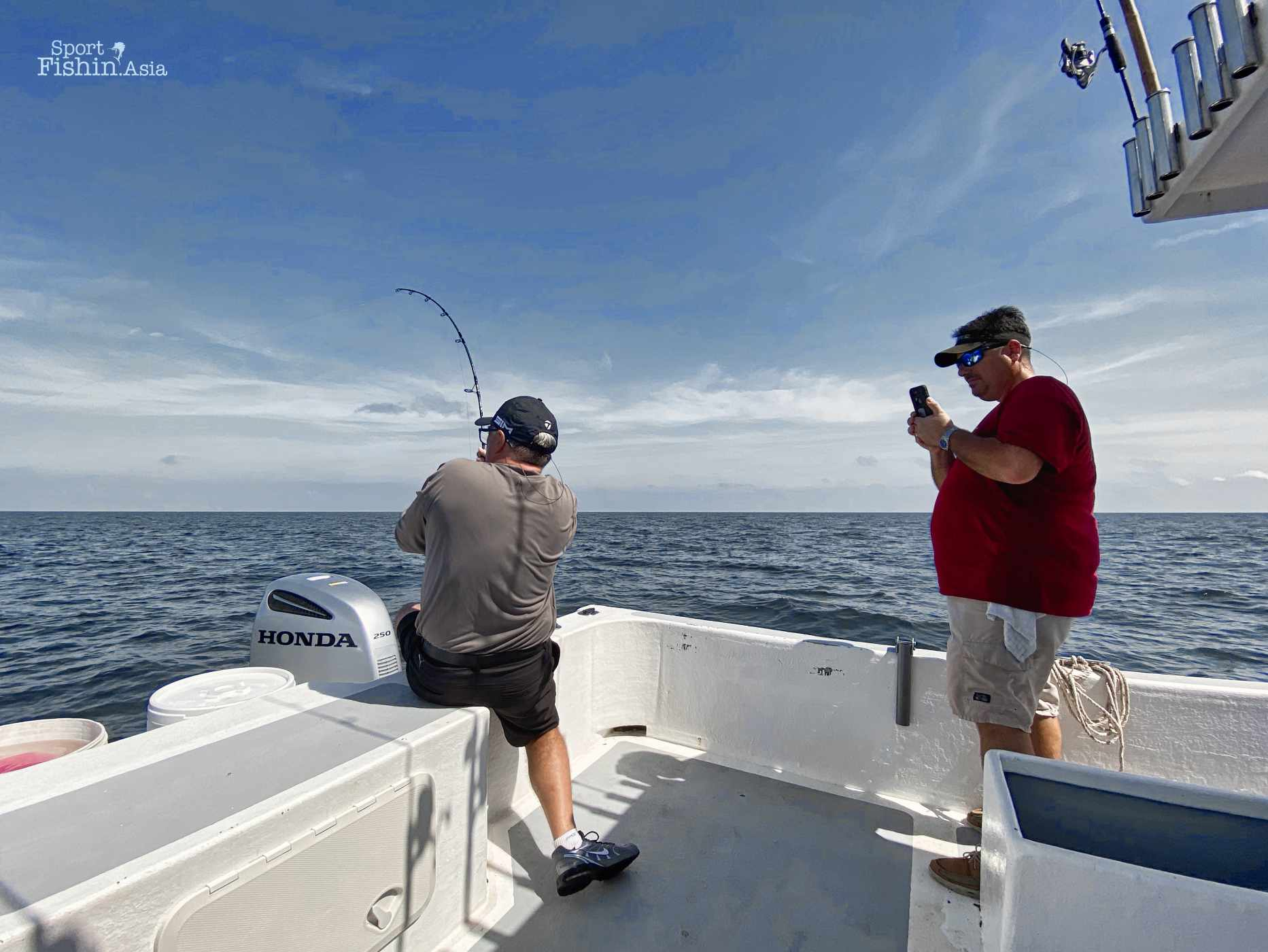 Ryan taking photos and videos of Brian with his first sailfish
